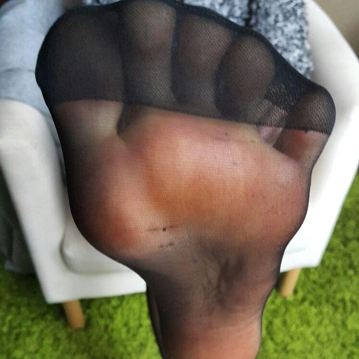 Feet soles in pantyhose