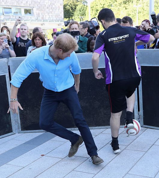 Prince Harry plays street hockey as part of the Streetsport initiative during a…