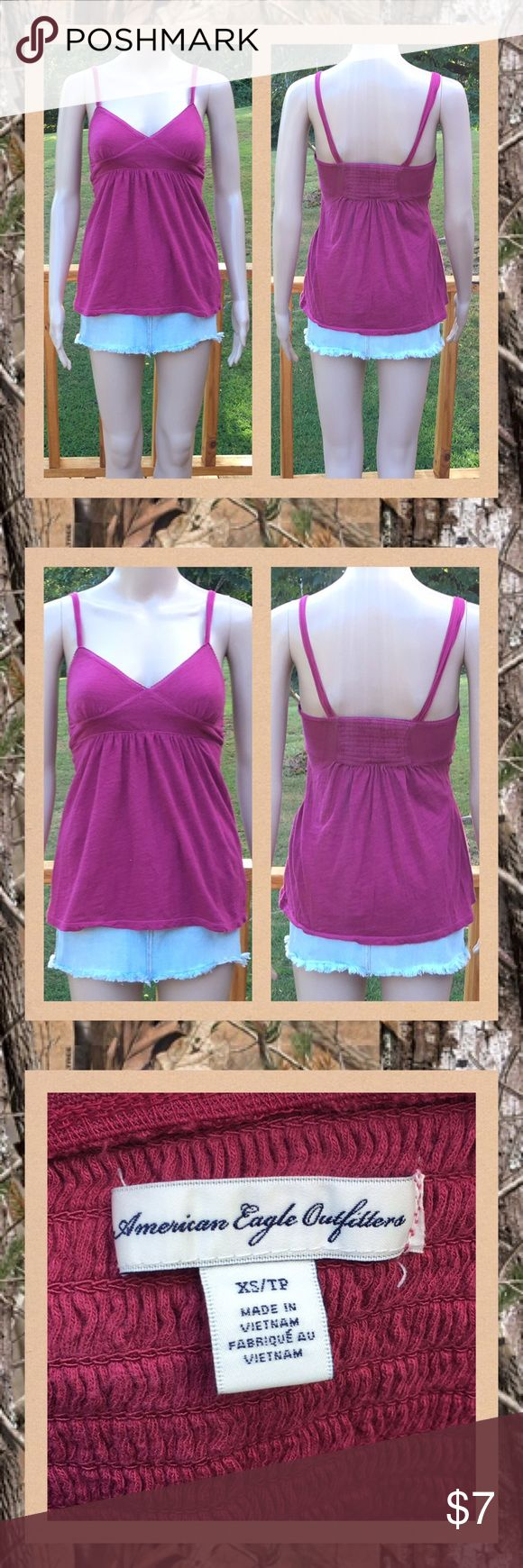 American Eagle Spaghetti Strap Tank Top American Eagle burgundyish spaghetti strap tank top, size x-small.  Thin and comfy with stretch to it. Elastic section in the back, babydoll style. Smoke free home. American Eagle Outfitters Tops Tank Tops