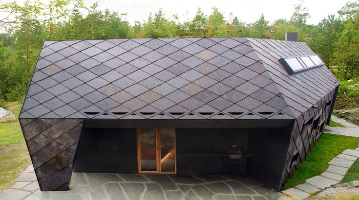Rugged Norwegian cabin is clad in slate shingles for protection against harsh winds
