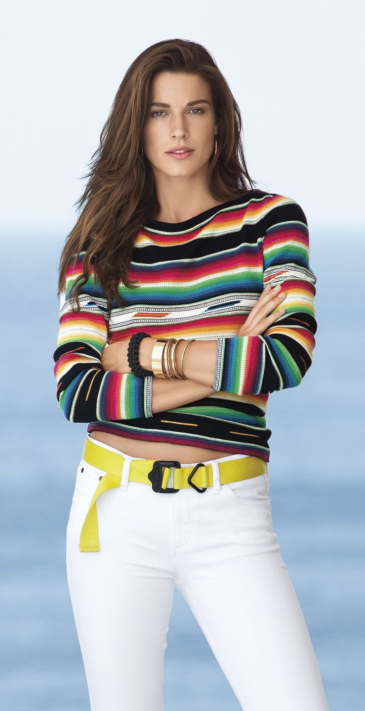 Crafted from a soft cotton blend, this beautiful long-sleeved sweater features a pretty bateau neckline and a vibrant allover serape-inspired pattern.