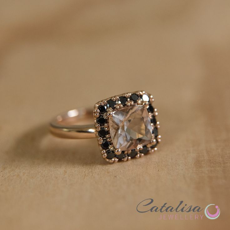 Morganite Diamond surrounded by smaller black diamonds, set in Rose Gold.