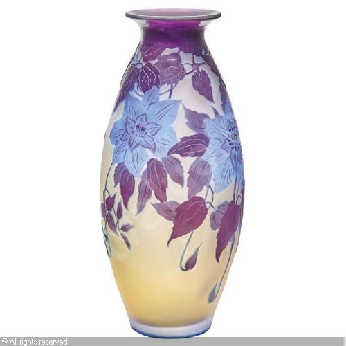 Galle acid etched cameo glass vase circa 1900 of ovoid form in plum over blue and frosted colorless glass decorated with pendent stylized blossoms and