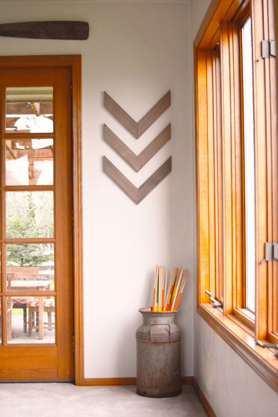 "Dress up your wall with these reclaimed wood chevrons. Made from western red cedar, these rustic wall ornaments are sure to add that special touch to any room. These are available in both weathered gray, and dark walnut stain. Because there are so many options for hanging these, we do not include hanging materials. We suggest command picture hanging strips for mounting them  Product details:  Set of Three  Featured in- Weathered Gray  Dimensions- 16"" x 12"" x .75""  Wood Type- Western Red…"