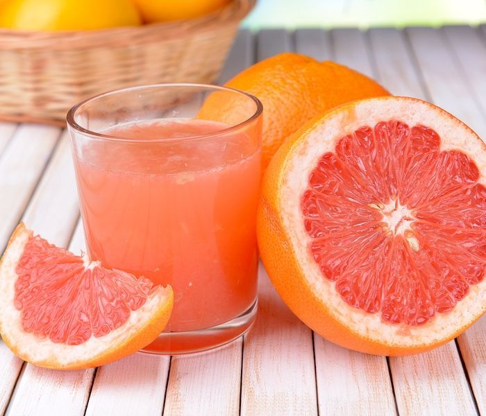 Grapefruit Benefits Weight Loss and Glowing Skin Grapefruit essential oil should also be used topically in a carrier such as coconut or almond oil because it helps reduce cellulite and fat by detoxifying skin and increasing circulation. Add 10 drops of essential oil to 1 oz of pure coconut or almond oil and massage on skin where toning and firming is needed.