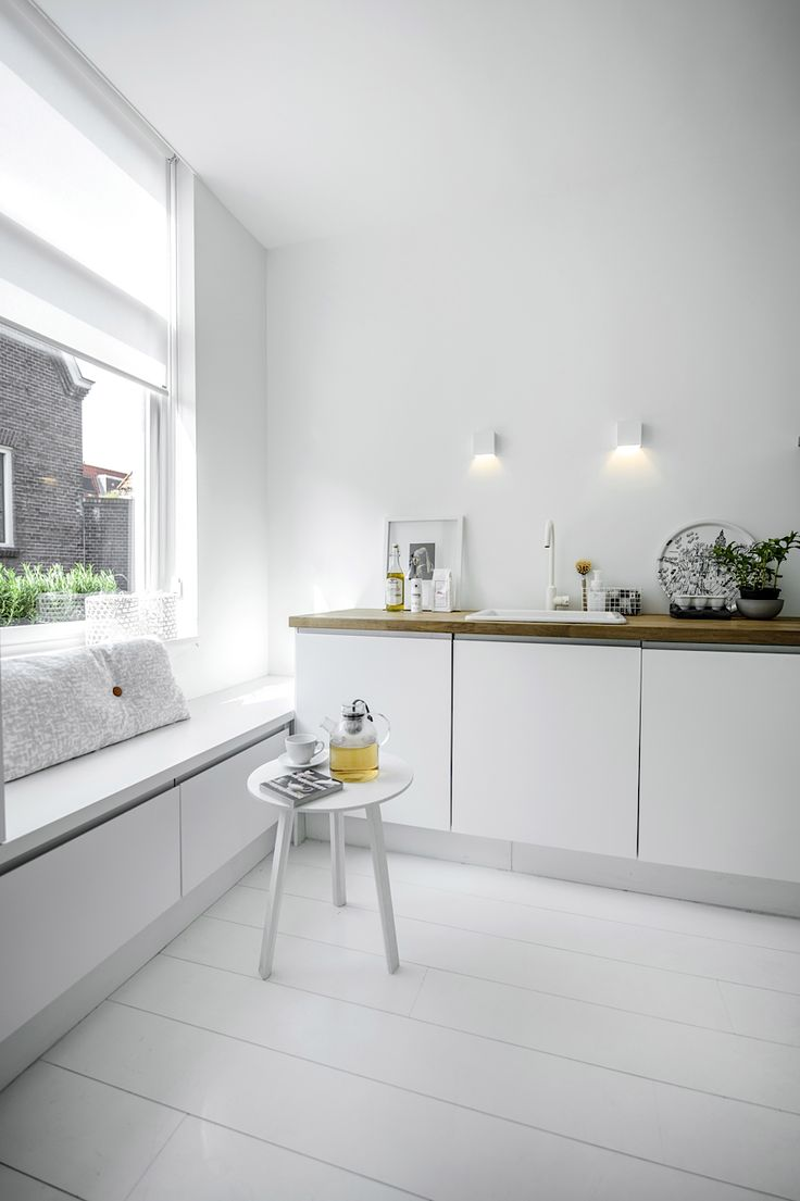 Inspiring Homes: White Heaven in Delft | Nordic Days Hay table and cushion and muuto tea kettle..get one of these!