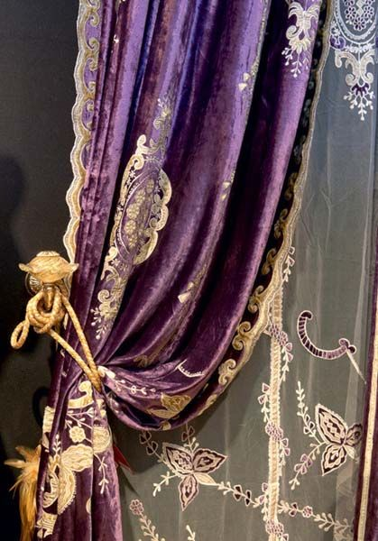 Purple draperies with golden cords and embroidered sheer curtains, interior design Renaissance style