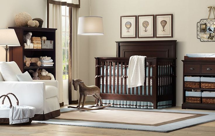 Stylish Design for Baby Boy Nursery  Dark Stained wood complements the blue with neutral & white accents.