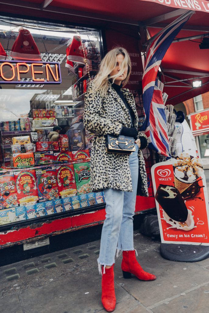 Leopard coat, mini bag, cropped frayed jeans, and red ankle boots