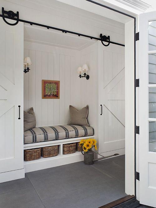 Lovely! Barn doors, built-in bench niche. via The Inspired Room