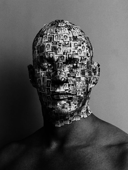 A stamp mask - I like the idea of his face being disguised by stamps, each stamp could possibly represent a different place.