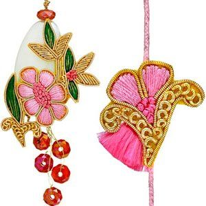Set of rakhi and lumba for Bhaiya and Bhabhi. The Lumba (rakhi for Bhabhi) is made of pink resham and zardosi flower design with small pink stones dangling at the bottom. It has a matching zardozi rakhi for brother. Rs 648/- http://www.tajonline.com/rakhi-gifts/product/rdr88/bhaiya-bhabhi-rakhi-set/?aff=pint2014/
