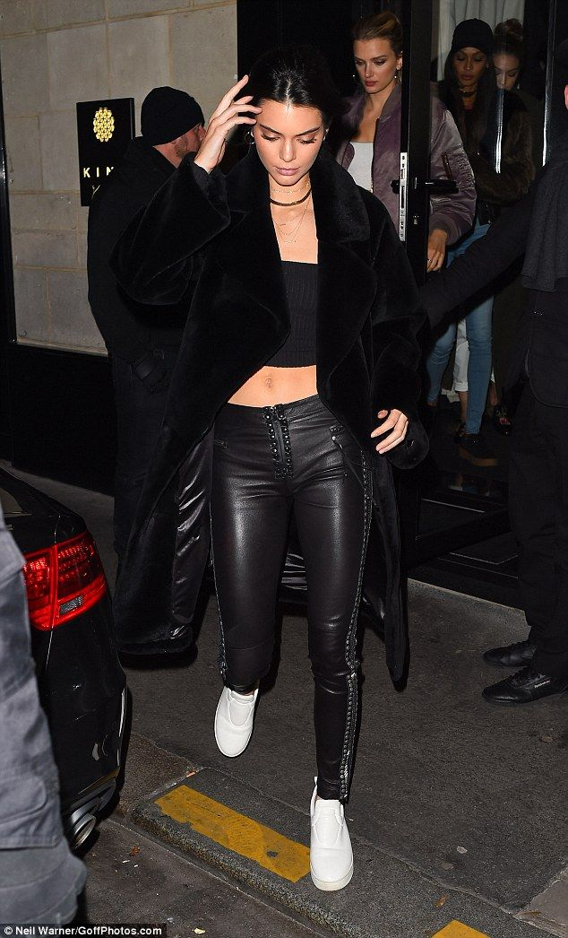 Turning heads: Kendall Jenner, 21,flaunted her lean legs in some racy studded leather leggings as she stepped out for dinner at the Japanese restaurant Kinugawa in Paris on Monday