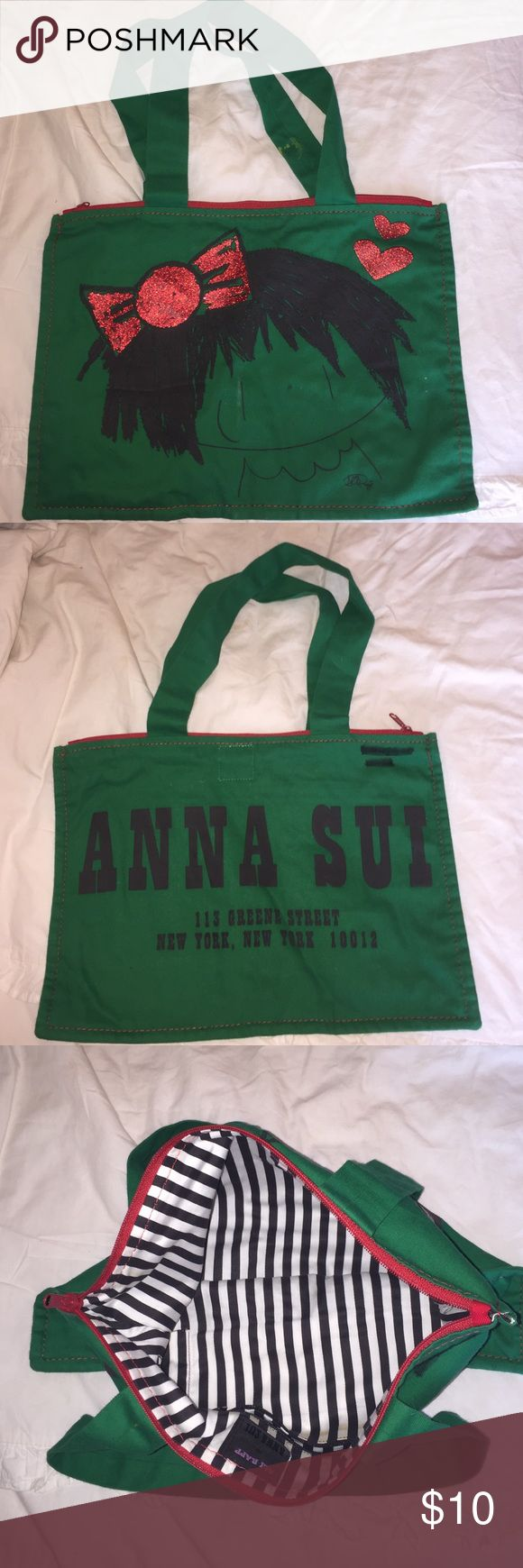 Anna Sui Tote This tote is gently used. 2 things to notice: 1. Paint stains on handles (shown in picture 1) 2. Black sharpie on back (shown in picture 2). Anna Sui Bags Totes