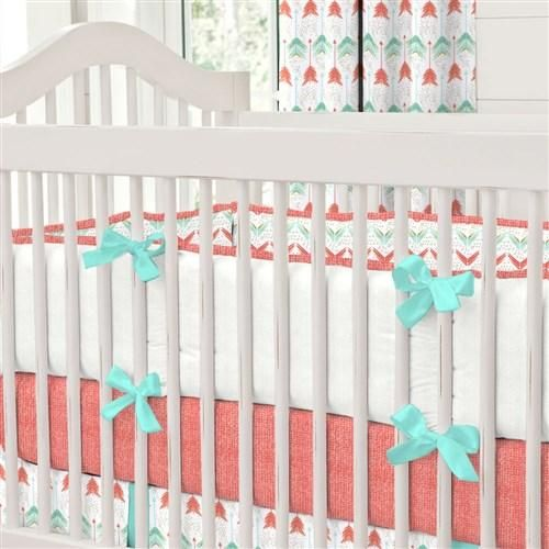 Coral and Teal Arrow Crib Bedding by Carousel Designs.