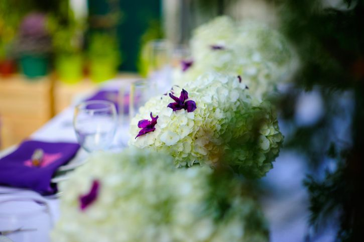 Purple inspired reception centerpieces by Dream Bloom and photos by Glen Cabotage