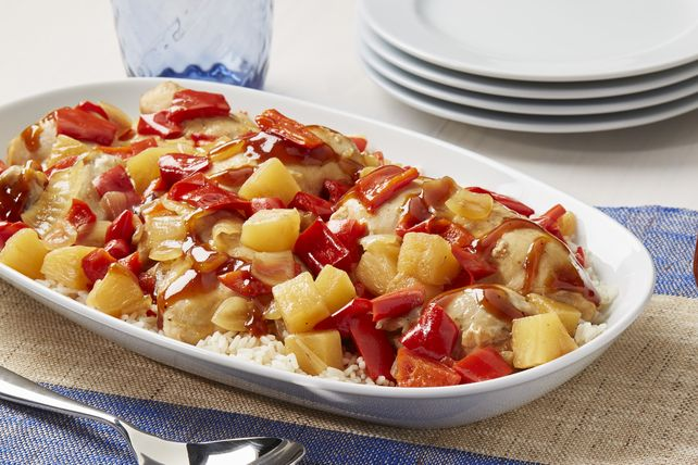 Cut-up pieces of a broiler-fryer chicken simmer in a sweet and sassy barbecue sauce with pineapple chunks and peppers to make this tasty slow-cooker dish.