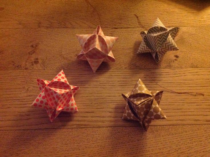 More paper stars for the christmas tree - quite fast to make, thank you for an easy tutorial!  http://femthe.blogspot.dk/2014/12/14-diy-terningestjerne.html