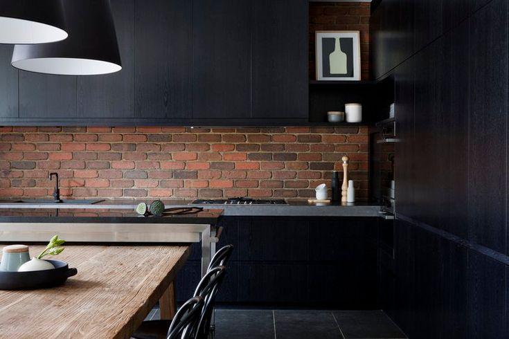 black kitchen interior with beautiful red contrasting brick backsplash - the Bridge Street Project by interior designer Beatrix Rowe