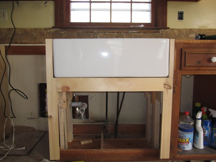 Reconstructed cabinet to support apron front sink.  ~  simple.beautiful.home: Kitchen Planning: Farm Sinks