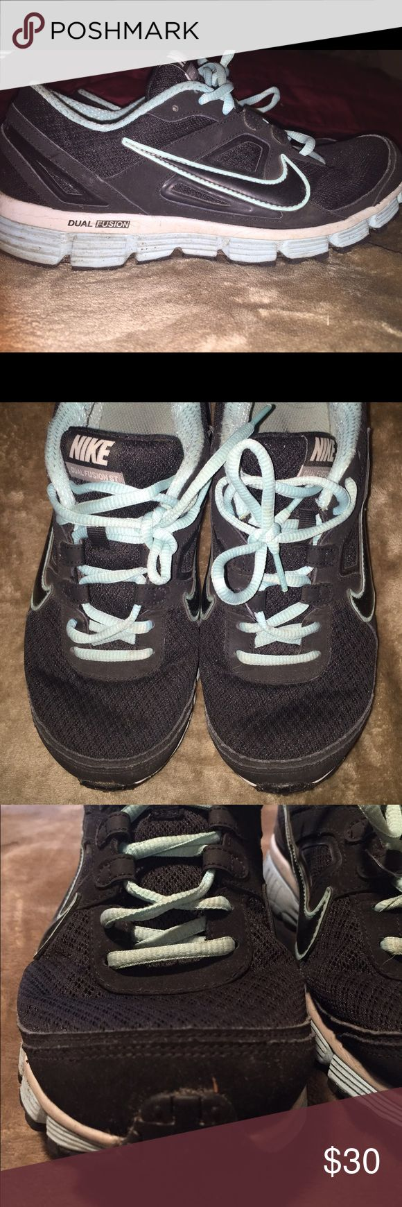 Nike Dual Fusion sneakers Black and light blue ladies size 9 dual fusion Nike athletic shoes. Still lots of life left in them. Can clean up the outside with a quick wipe down. Nike Shoes Athletic Shoes