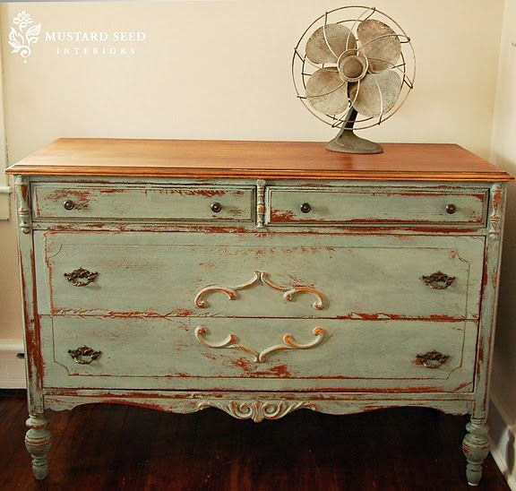 Love the original design this dresser. I also like how the top is not painted and how she used old knobs. A little more distressed than I like, but still beautiful.