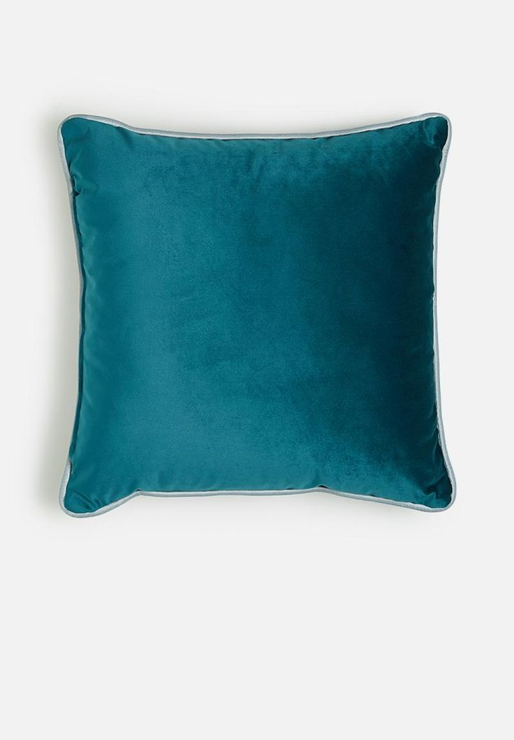 Soften up your space with a stylish selection of cushions. Bringing together complementary shades of blue, this design will mix and match well with other colours and comes complete with the inner.
