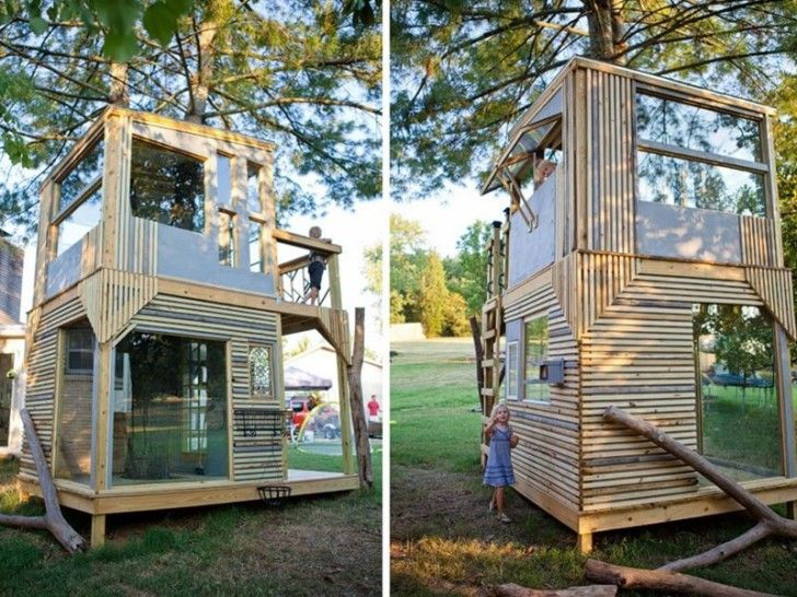 Dad builds a dreamy, airy two-story treehouse with his kids