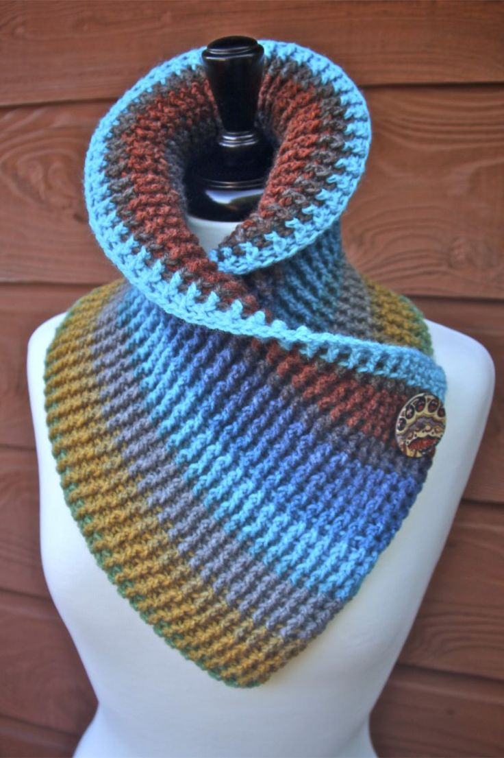 Free Crochet pattern for a really cute and sassy Autumn Ribbed Cowl with button accent including video tutorials using one cake Mandala Lion Brand Yarn.
