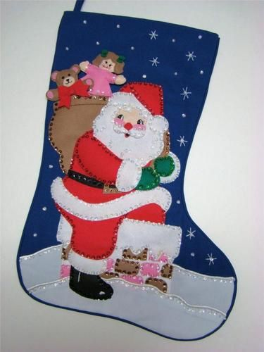 """This wonderful Christmas Stocking called """"Here He Comes"""" is made of felt applique on cloth and beautifully decorated with hand sewn sequins and beads. Many hours of work went in to completeing this beautiful heirloom stocking measuring approx. 21"""" diagonaly and 10"""" across the top. Lots of room to stuff."""