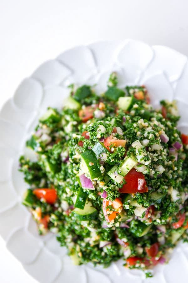 A refreshing parsley salad with bulgur wheat, tomatoes, cucumbers and tomatoes dressed with a lemon vinaigrette. Tips for making the best tabouleh.