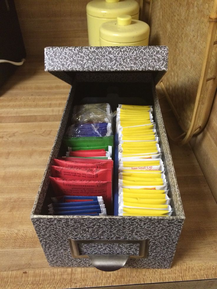 I use our old Photo storage box used to store tea bags! So cute and you can use the movable divider to keep them straight.