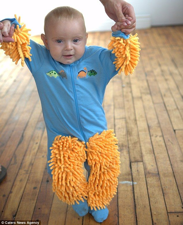 Help at home: In their blurb for the babygro the firm jokes that the outfit will teach your baby a strong work ethic early on in their life