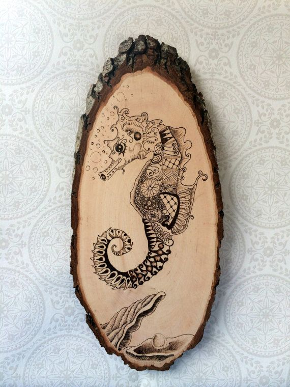 This cute Zentangle seahorse and oyster with pearl has been drawn by hand onto a Basswood tree slice and then hand burned with a pyrography