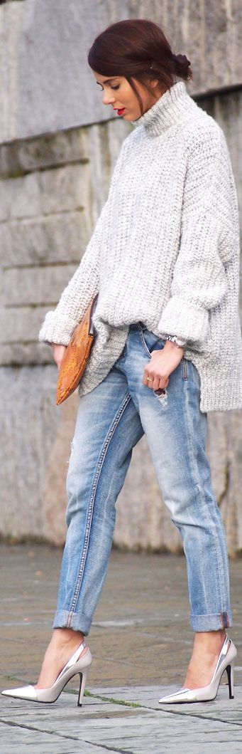 Oversized sweater, distressed denim, and heels.