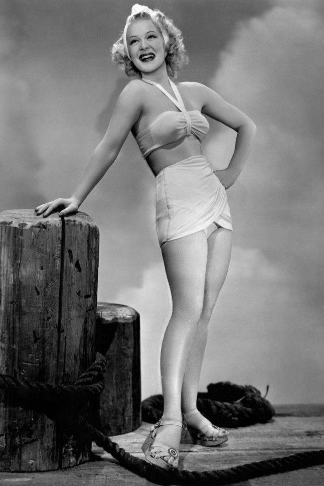 Betty Hutton, 1945 Betty rocks a halterneck bikini and wedges witha turban-style headband. No wonder she's smiling. Hot.