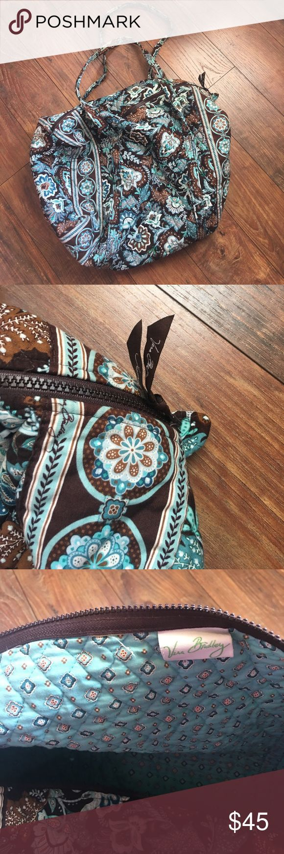 Vera Bradley blue and brown print duffel bag Vera Bradley blue and brown print duffel bag. Perfect condition. 21x16x11 inches. Perfect for a carry on. No holds or trades. ❤️❤️❤️ Vera Bradley Bags Travel Bags