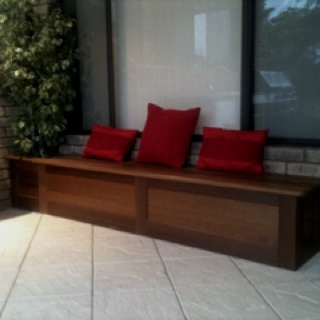 Outdoor patio seating with lift up lid for storage. By Peter walker furniture, Perth, western Australia