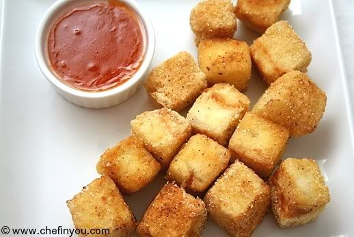 Crispy Fried Tofu Recipe in Sweet Chilli Sauce Recipe.  I make a version of this where the tofu is in sticks, not cubes (like the size of art pastels) and the sauce is served over it.  I use traditional chili sauce that you can easily find, instead of the Sambal Oelek this calls for.  I serve with rice and eat until I nearly pop.
