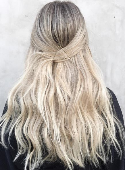 Beach waves with hair pulled back.