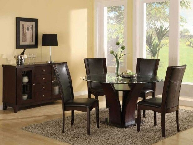 Dining Room. Interesting Dining Room Design Ideas Round Table Dominated By Wood. Awesome Dining Room Design Ideas Round Table Featuring Glass Round Top Dining Table With Dark Brown Wood Legs And Dark Brown Leather Dining Chair With Wooden Legs Plus Glass Vase Together With Dark Brown Varnished Wood Free Standing Storage As Well As Black Mate Table Lamp With Finish Chrome Lamppost Plus Wine Glass Also Black White Picture Frame As Well As Gray Fur Rug And Icy Yellow Painted Wall Plus Wooden…