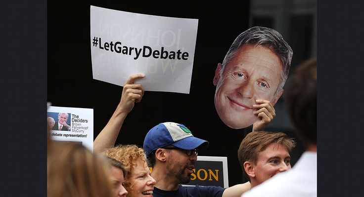 Supporters of Libertarian presidential candidate Gary Johnson rally in front of the Commission on Presidential Debates on Sept. 30 in Washington, D.C. (Getty)