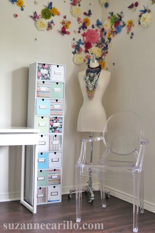 I love the former CD tower remade into office storage but really love the butterflies/flowers on the wall