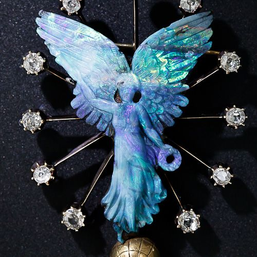 Beautiful piece of jewelry!!  Carved Opal and Diamond 'Nike' Brooch - 50-1-4611 - Lang Antiques