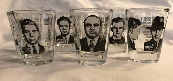 Set of 6 gangster shot glasses! The bad boys of crime featured on each glass is mug shots & rap sheets. Included in the set: Al Capone, Bugsy Siegel, John Dillinger, Lucky Luciano, Pretty Boy Floyd, and, Machine Gun Kelly No chips or cracks.