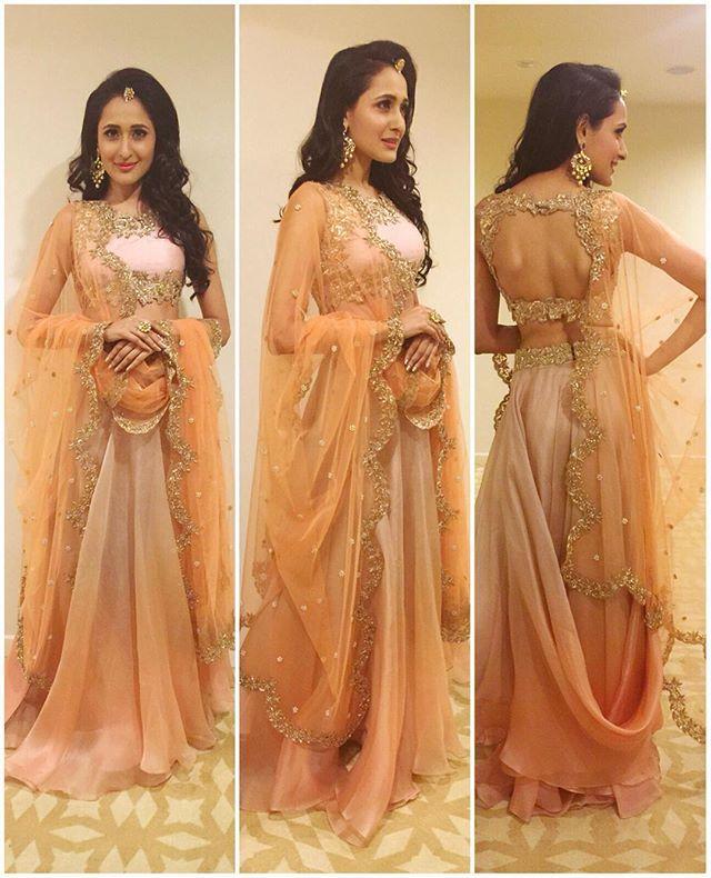 Actress Pragya Jaiswal @jaiswalpragya looking dainty in our sunset peach drape lehenga! ❤️