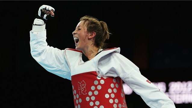 Jade Jones of Great Britain celebrates beating Li-Cheng Tseng of Taipei during the semifinal Women's -57kg Taekwondo match on Day 13 .
