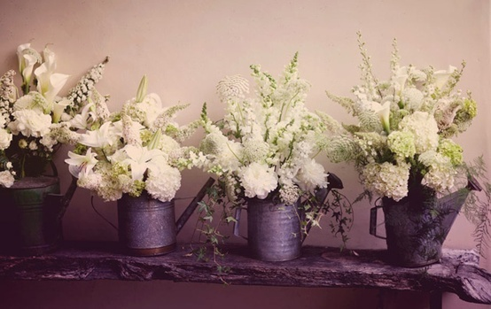 love the old watering cans :-) centerpieces?