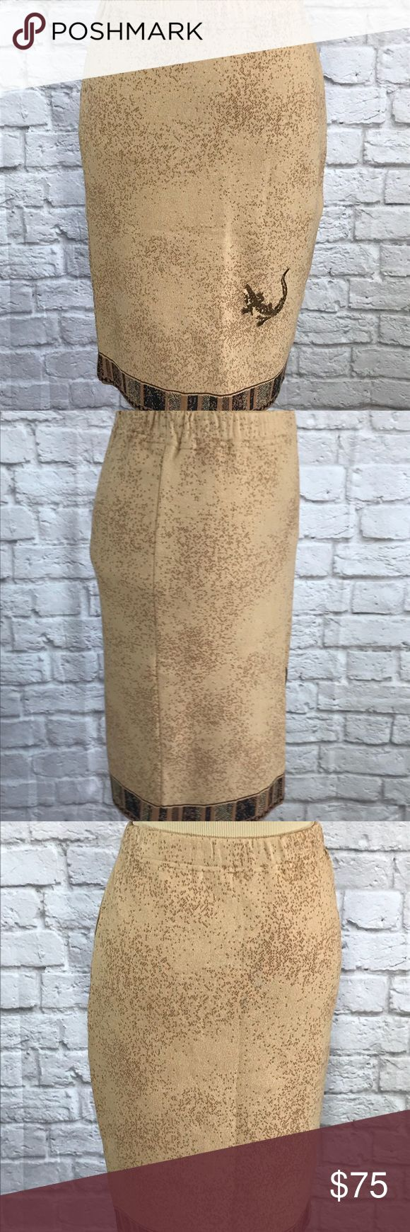 St. John Collection camel/brown pencil skirt 6 St. John Collection Knit pencil skirt size 6. The fabric is camel with a brown tweed. There is a crocodile embroidered on the front and a border on the skirt. The skirt is in perfect condition except for a repaired hole on the back of the waistband. Please see pictures for garment detail and measurements. Thanks for visiting my closet! St. John Collection Skirts Pencil