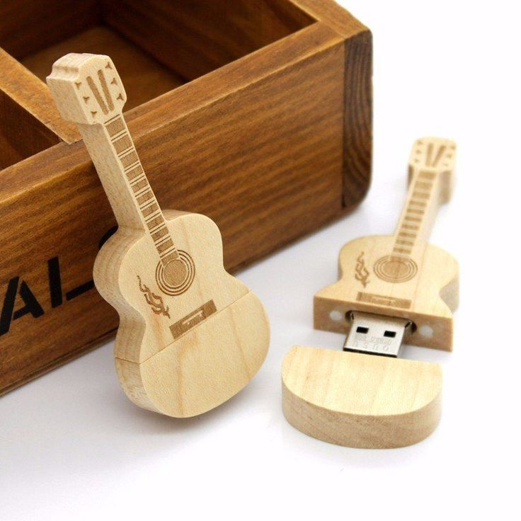 Know someone that loves guitar? Store your latest HITS on this wood usb guitar!